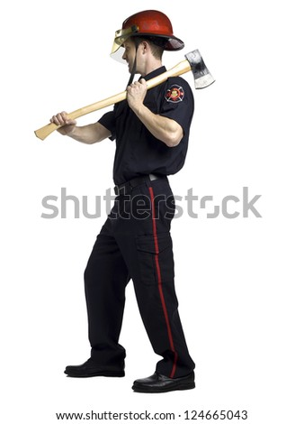 Full length image of a firefighter holding an ax - stock photo