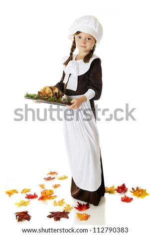 Full-length image of pretty elementary Pilgrim girl carrying a wooden plate of roast bird with veggies.  On a white background. - stock photo