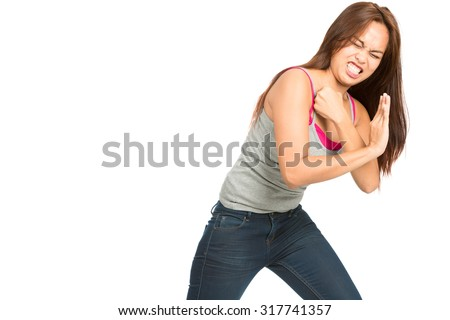 Full length isolated white background profile of spokes model Asian female, casually dressed, arms out to side, body language presenting, showing inserted product placement looking away to the side - stock photo