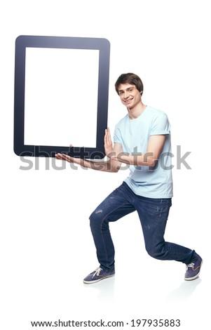 Full length man carrying tablet frame, over white background - stock photo