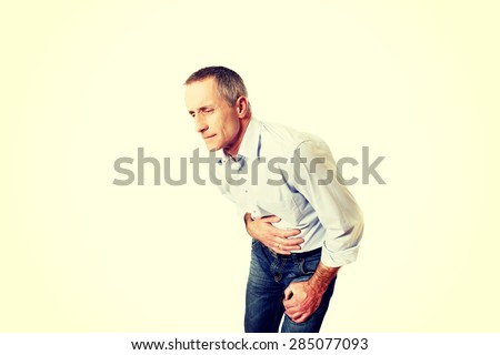 Full length mature man suffering from stomachache. - stock photo