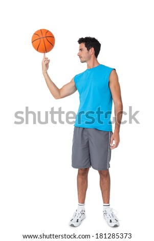 Full length of a basketball player with ball isolated on white background - stock photo