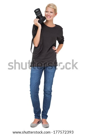 Full length of a beautiful female photographer over white background - stock photo