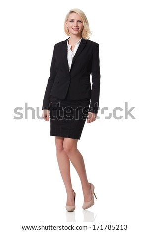 full length of a beautiful young blonde woman standing and smiling; white background - stock photo