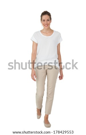 Full length of a casually dressed young woman over white background - stock photo