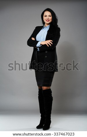 Full length of a confident businesswoman with her arms crossed - stock photo