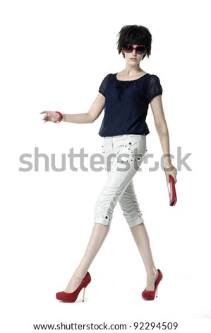 Full length of a fashion model practicing catwalk - stock photo