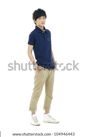 Full length of a happy young guy standing against isolated white background - stock photo