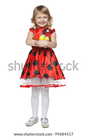 Full length of a little girl holding a basket with Easter eggs, isolated on white background - stock photo