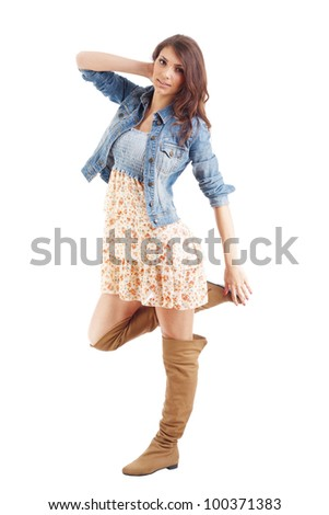 Full length of a pretty young girl posing isolated in white - stock photo