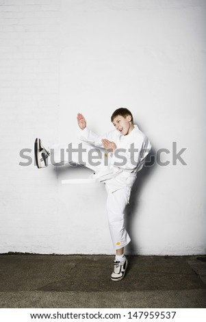 Full length of a young boy practicing judo - stock photo
