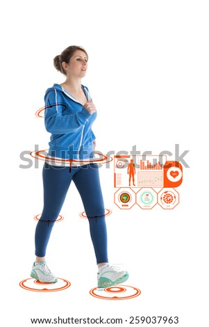 Full length of a young woman walking against fitness interface - stock photo