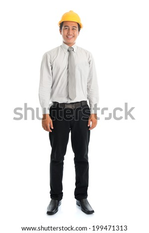 Full length of an Asian young man wearing a hardhat smiling and looking at camera, standing isolated on white background. - stock photo