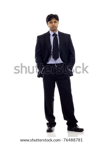Full length of an Indian business man standing with hands in pocket isolated over white background. Studio shot. - stock photo