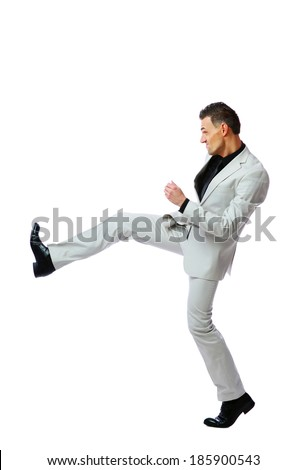 Full length of angry businessman imitating a fight standing against white background - stock photo