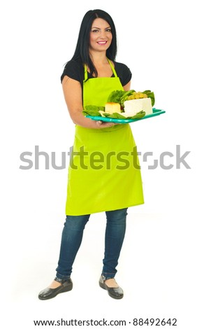Full length of attractive cheese maker female holding full plateau with different type of cheese isolated on white background - stock photo