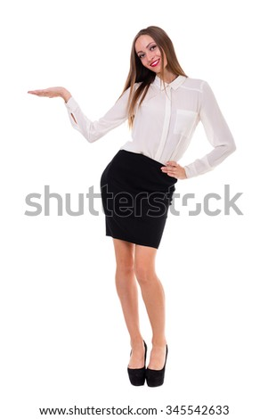 Full length of beautiful business woman standing  over isolated white background with copy space - stock photo