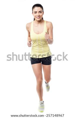 Full length of beautiful fitness woman jogging - stock photo