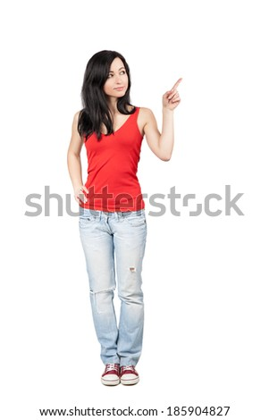 Full length of beautiful teen girl showing / pointing to the right, isolated over white background - stock photo
