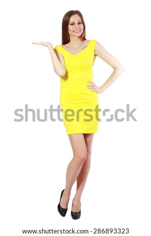Full length of beautiful woman showing / presenting / holding on the palm blank copy space over white background - stock photo