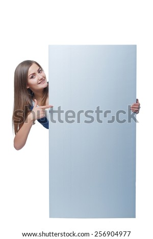 Full length of beautiful woman standing behind, holding  blank advertising board banner, over white background - stock photo
