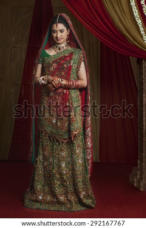 Full length of beautiful young bride standing - stock photo