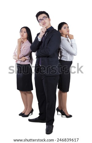 Full length of business team daydreaming in the studio, isolated on white background - stock photo