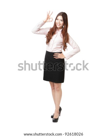 Full length of business woman showing OK hand sign happy smile isolated on white background. Young pretty Asian businesswoman - stock photo