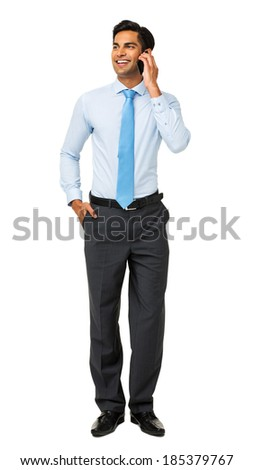 Full length of businessman looking away while using smart phone over white background. Vertical shot. - stock photo