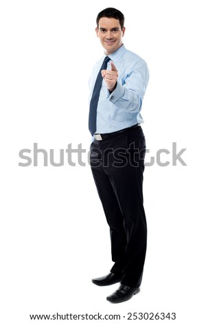 Full length of businessman pointing his finger at you - stock photo