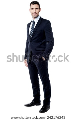 Full length of businessman with hand in pocket - stock photo