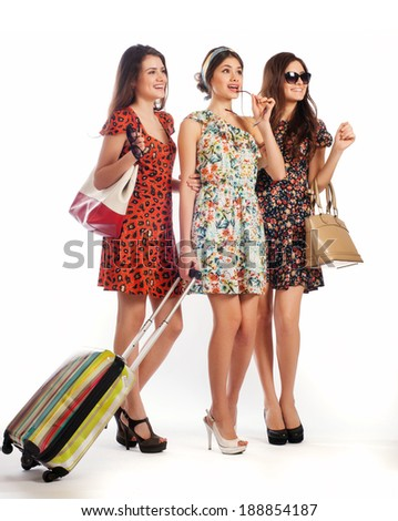 Full length of casual women standing with travel suitcase - isolated on white background - stock photo