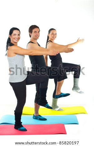 Full length of cheerful group of sport people workout and standing on colorful mats against white background - stock photo