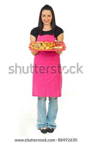 Full length of confectioner woman in pink apron holding cakes isolated on white background - stock photo