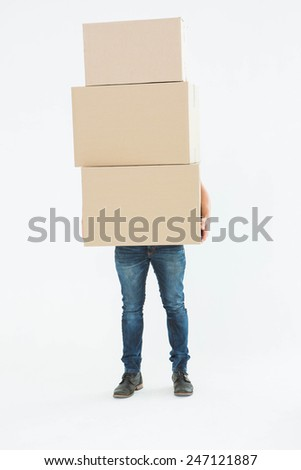 Full length of courier man carrying cardboard boxes on white background - stock photo