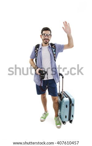 Full length of excited man travelling with luggage and camera. Isolated on white background - stock photo