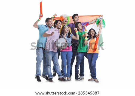 Full length of excited young friends looking away while cheering with Indian flag over white background - stock photo