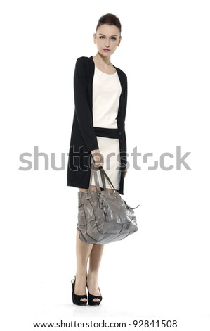 Full length of fashion model with big bag. Isolated on white - stock photo
