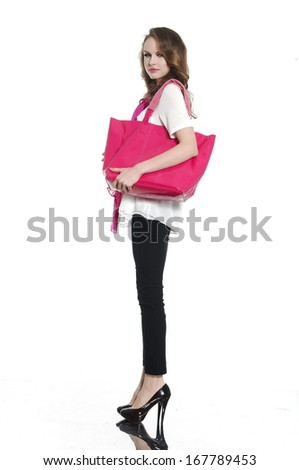 Full length of fashion model with the bag on a white background - stock photo