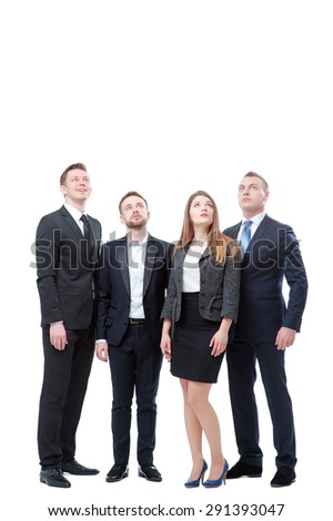 Full length of group of interested business people looking up. Isolated on white. - stock photo