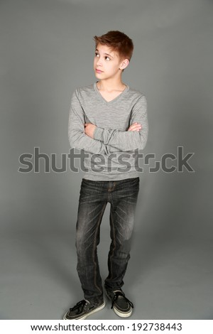 full length of handsome preteen boy looking to side - stock photo