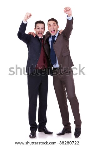 Full length of handsome two business men winning on hite background - stock photo