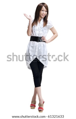 Full length of happy cheerful beautiful Japanese Asian young woman holding her hand out and showing copy space for your product. - stock photo