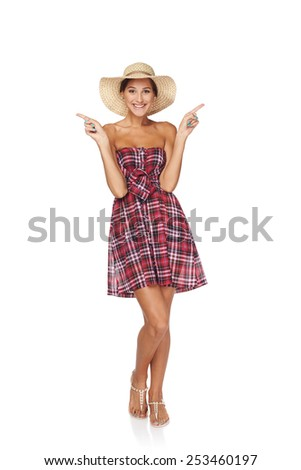 Full length of happy excited woman in summer country style pointing two fingers at blank copy space upwards, isolated on white  backgorund - stock photo