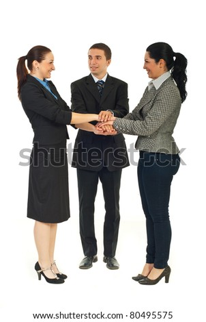 Full length of happy united business people with their hands on top each other isolated on white background - stock photo
