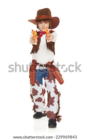 Full length of little boy in a suit of the cowboy pointing the guns at camera, on a white background - stock photo
