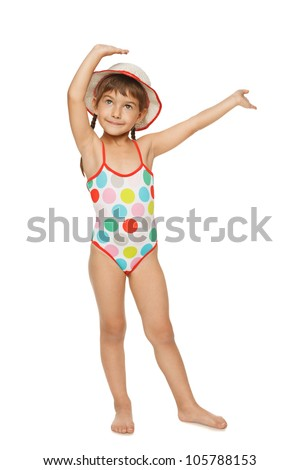 Full length of little girl in swimsuit and panama hat with hands raised, isolated over white background. - stock photo