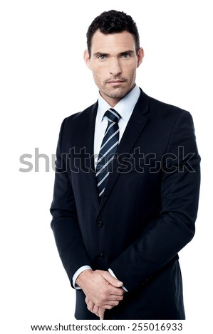 Full length of male entrepreneur with hands clasped - stock photo