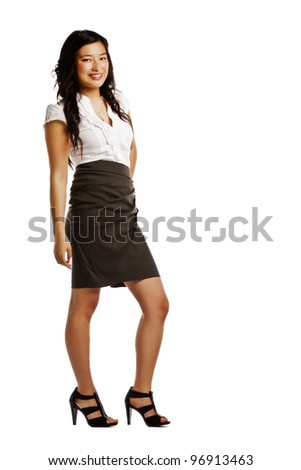 Full length of pretty young asian business woman posing for camera - stock photo