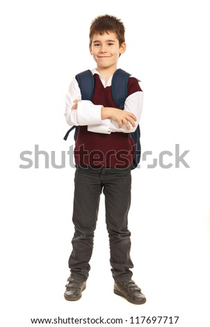 Full length of student boy at primary school with back bag standing  with arms folded isolated on white background - stock photo